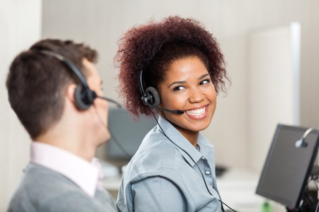 Customer Service Representatives Talking In Call Center photo