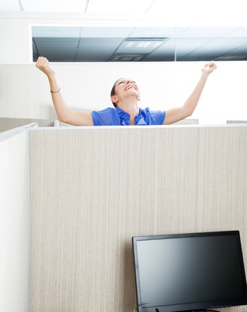clenching fists: Customer Service Representative Celebrating Success In Cubicle