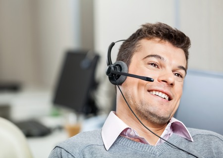 Smiling Customer Service Representative Wearing Headset Stock Photo