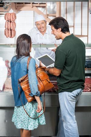 carnicer�a: Pares con tableta digital en Carnicer�a