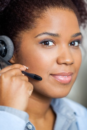 Portrait Of Young Female Customer Service Representative Wearing