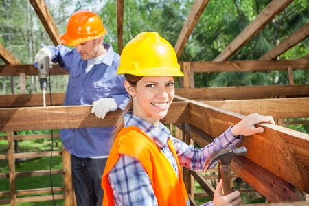 timber frame: Workers Working In Timber Frame At Site Stock Photo