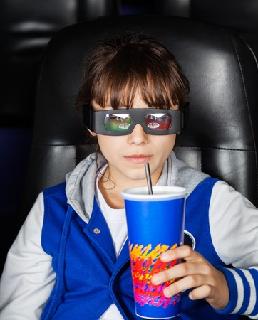 3d: Girl Having Drink In 3D Cinema Theater Stock Photo