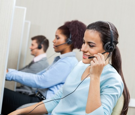 customer service representative: Female Customer Service Representative Talking On Headset
