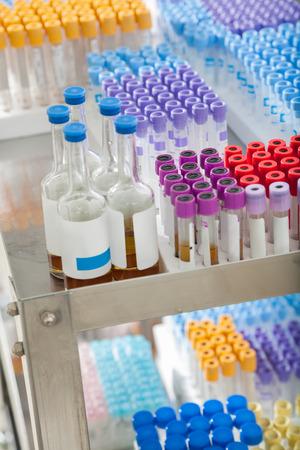 arranged: Test tubes and bottles arranged on medical trolley