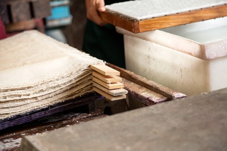 Closeup of stacked paper sheets drying in factory Stock Photo