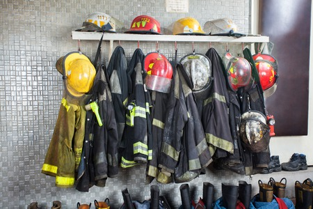 Firefighter's uniforms and gear arranged at fire station 스톡 콘텐츠