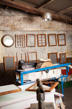 paper factory: Various frames hanging in paper factory