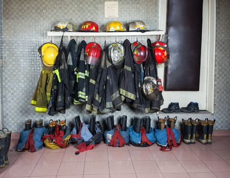 firefighter: Firefighter suits and gear arranged at fire station