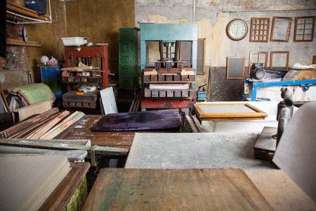 Interior of paper factory with tools Stock Photo