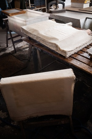 printmaking: High angle view of papers drying in factory