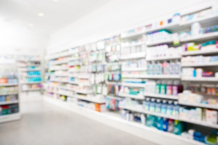 Products arranged in shelves at pharmacy Stock Photo