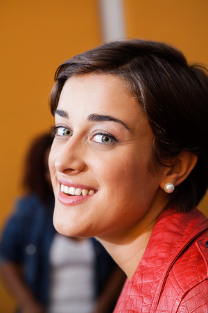 brown eyes: Portrait of smiling female musician in recording studio Stock Photo