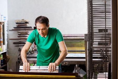 atelier: Silkscreen artist in atelier creating artwork
