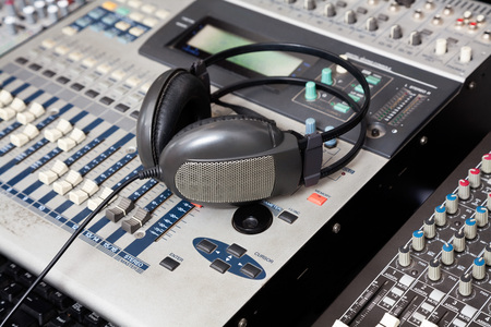 microphones: Closeup of headphones on music mixer in recording studio