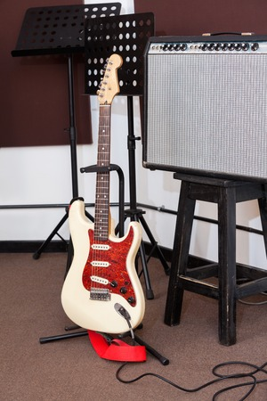 tuner: Electric guitar and tuner in recording studio