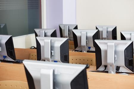 school classroom: Computers monitors arranged on desks in classroom