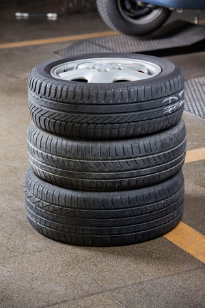 aluminum wheels: Stack of rubber tires at garage Stock Photo