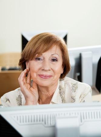 old women: Portrait of happy senior woman in computer class Stock Photo