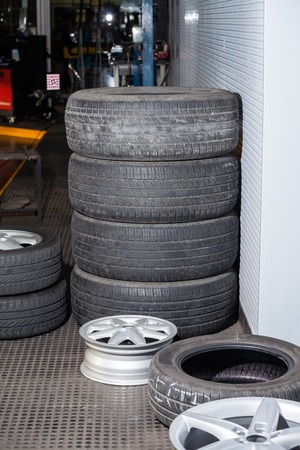 auto repair: Stack of rubber tires at auto repair shop