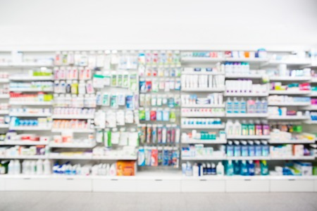 store display: Defocused image of medicines arranged in shelves at pharmacy