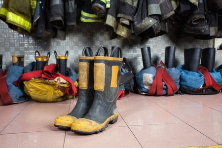 fire fighting equipment: Firefighters boots on tiled floor at fire station
