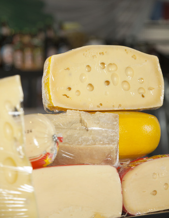 speciality: Close-up of cheese pieces displayed in shop at supermarket