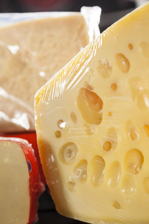 displayed: Closeup of packed cheese displayed in store at market