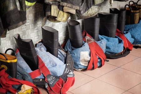 firefighting: High angle view of firefighters boots on tiled floor at fire station