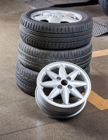 alloy: Stack of rubber tires and alloy at auto repair shop