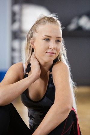 girl sport: Thoughtful young woman looking away while sitting in health club Stock Photo