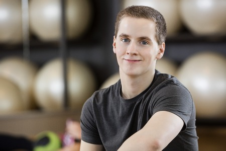young man portrait: Portrait of young man smiling in fitness center