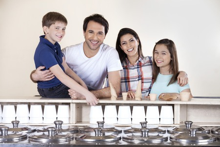 family portrait: Portrait of happy family at counter at ice cream parlor