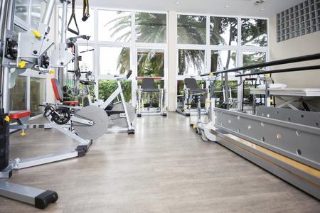 Exercise equipment in fitness studio of rehab center 스톡 콘텐츠