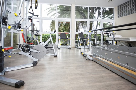 Exercise equipment in fitness studio of rehab center