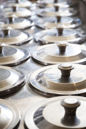 gelati: Rows of lids on ice cream containers at parlor