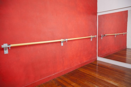 ballet bar: Ballet bar against red wall in rehearsal room