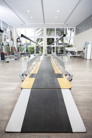 fitness center: Walking equipment with bars in nursing home