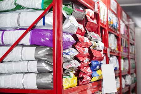 Pet food packets arranged on shelves at store