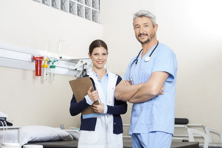 physiotherapists: Portrait of confident physiotherapists standing in rehab center Stock Photo