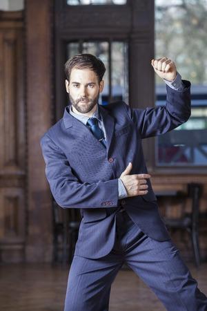 argentina dance: Portrait of male dancer in suit performing Argentine tango in restaurant