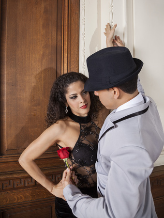 argentina dance: Young tango dancer holding for female partner in restaurant Stock Photo