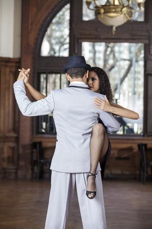 sensuous: Sensuous woman looking at man while performing tango in restaurant