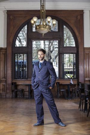 argentina dance: Full length portrait of confident male tango dancer standing in restaurant Stock Photo
