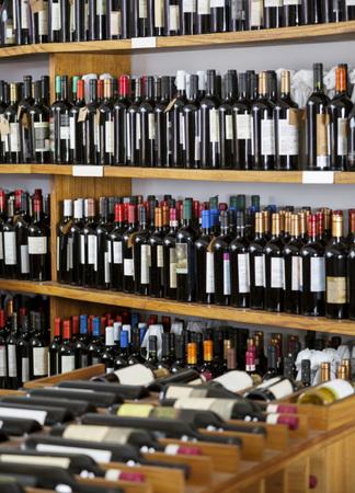wine stocks: Wine bottles displayed on shelves in supermarket