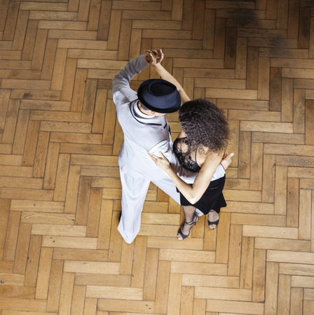 hardwood floor: High angle view of male and female dancers performing on hardwood floor at restaurant