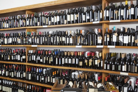 Wine bottles displayed on shelves in restaurant