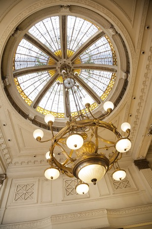 architectural lighting design: Low angle view of chandelier hanging from cupola in cafe