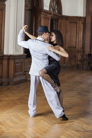 tango: Passionate male and female tango dancers performing in restaurant