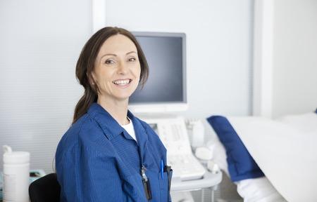 radiologist: Portrait of confident radiologist smiling in hospital